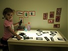 photo of girl working on art project at a light table at the Dixon Millennium Child Care and Development Center